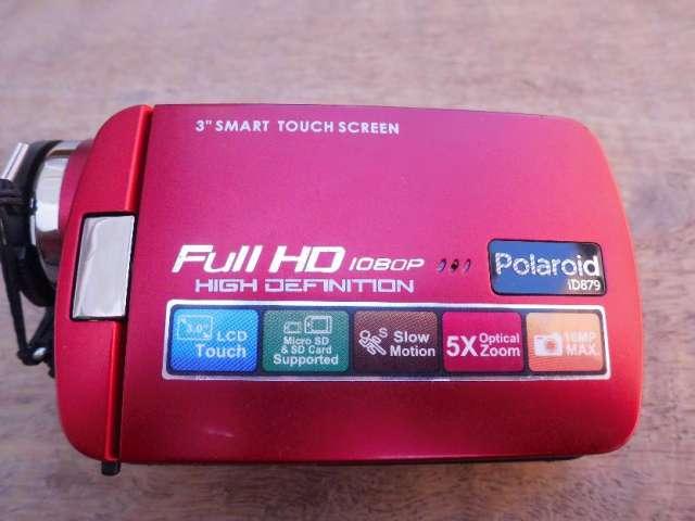 Vendo camara de video polaroid alta definicion full hd con tripode grande